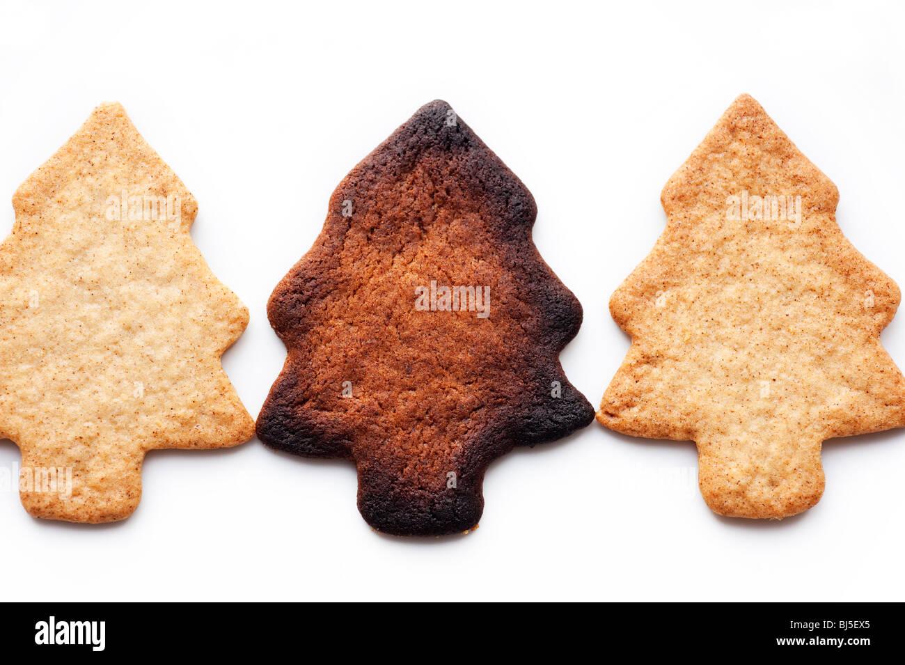 Three Cinnamon Christmas Tree Shaped Cookies One Burnt Stock Photo