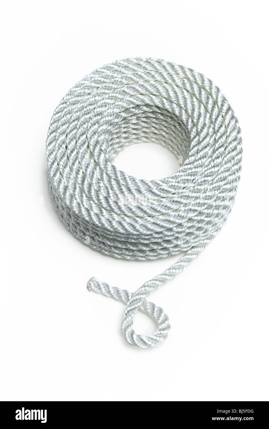coiled white nylon rope - Stock Image