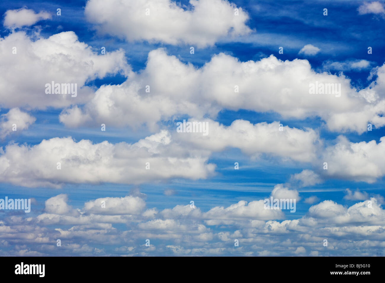 blue sky with white fluffy clouds background Stock Photo