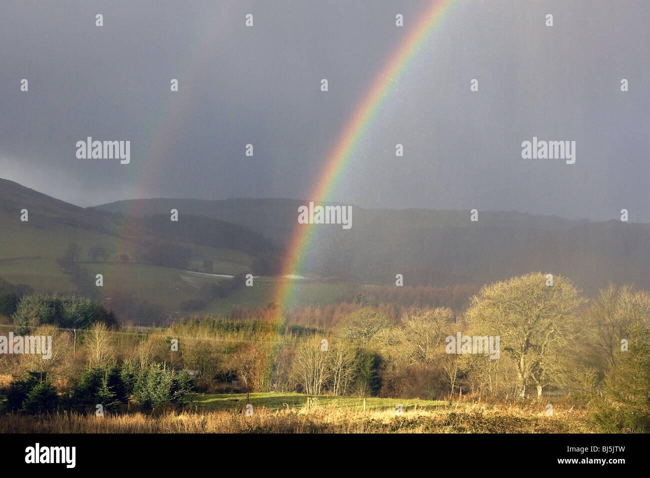 Rainbow in Ysbyty Ystwyth in Wales. - Stock Image