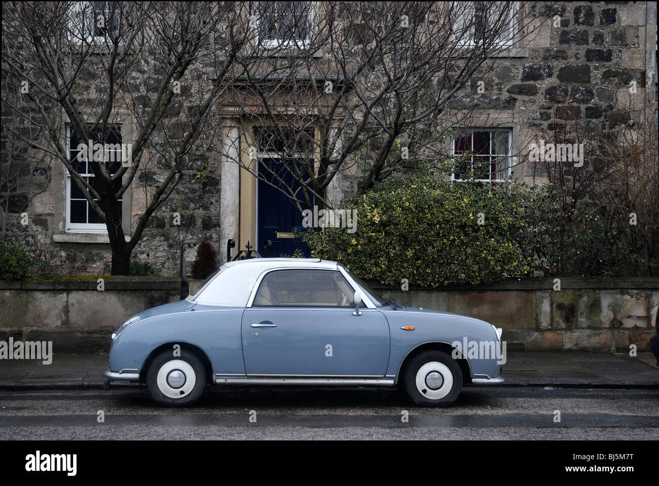 A blue and white Nissan Figaro parked near Leith Links in Edinburgh - Stock Image
