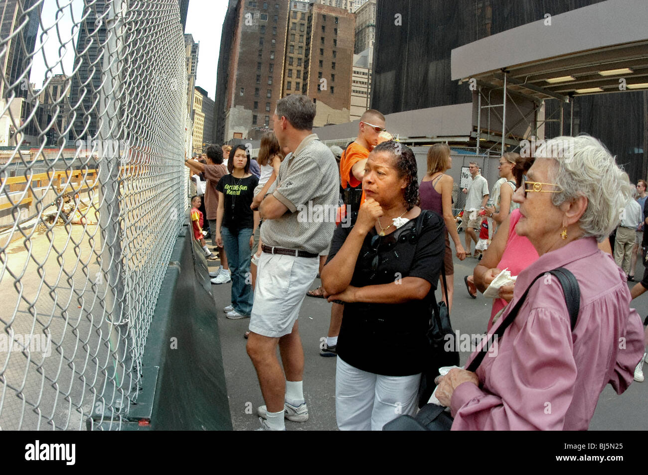 Group Tourists, Looking, in mourning, at 9/11 Ground Zero Site, New York. - Stock Image