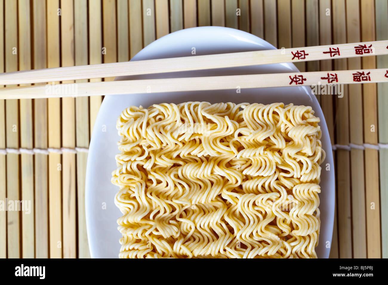 chopsticks and noodles Stock Photo