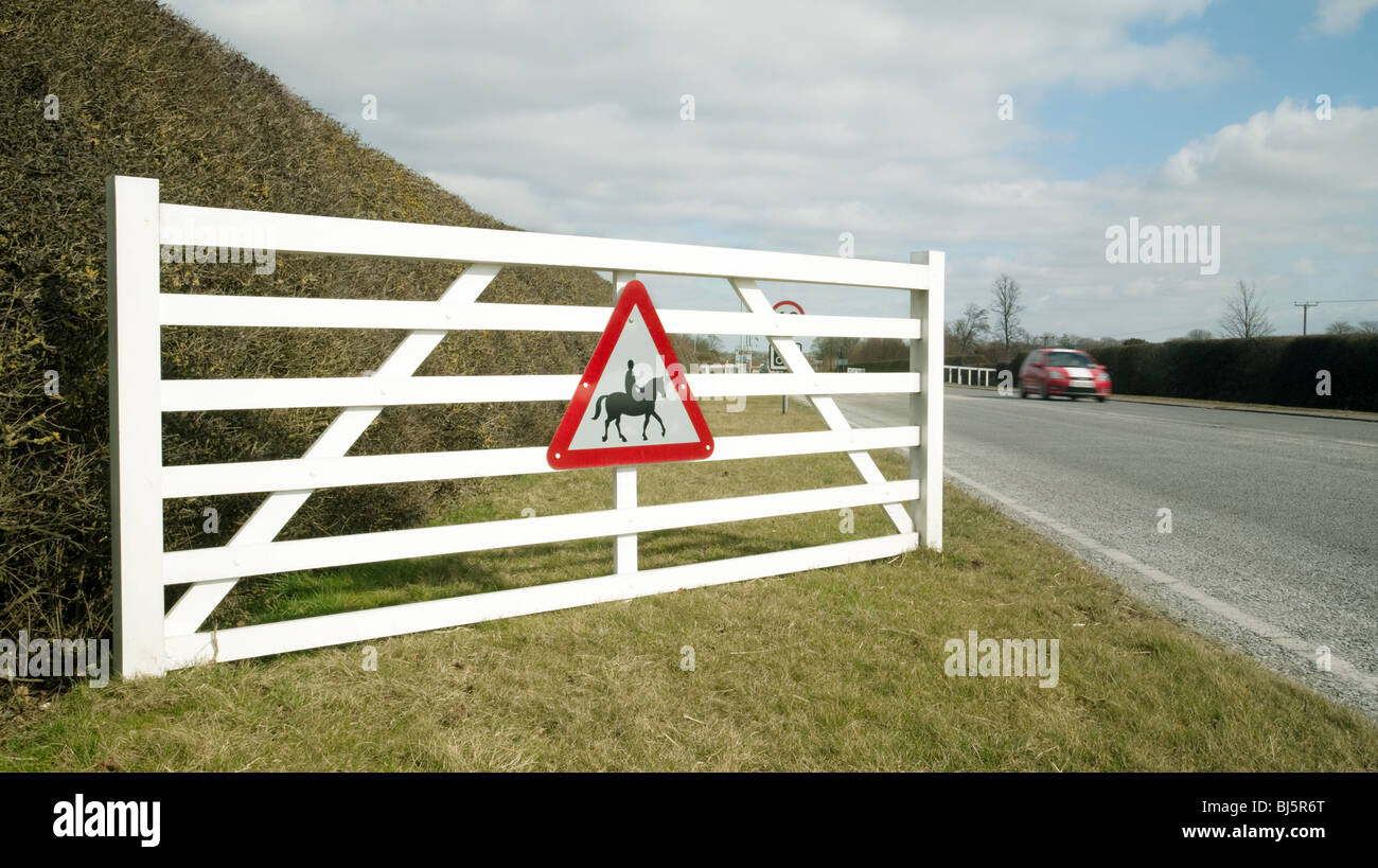 Beware of horses road sign at the entrance to Newmarket, Suffolk, UK - Stock Image