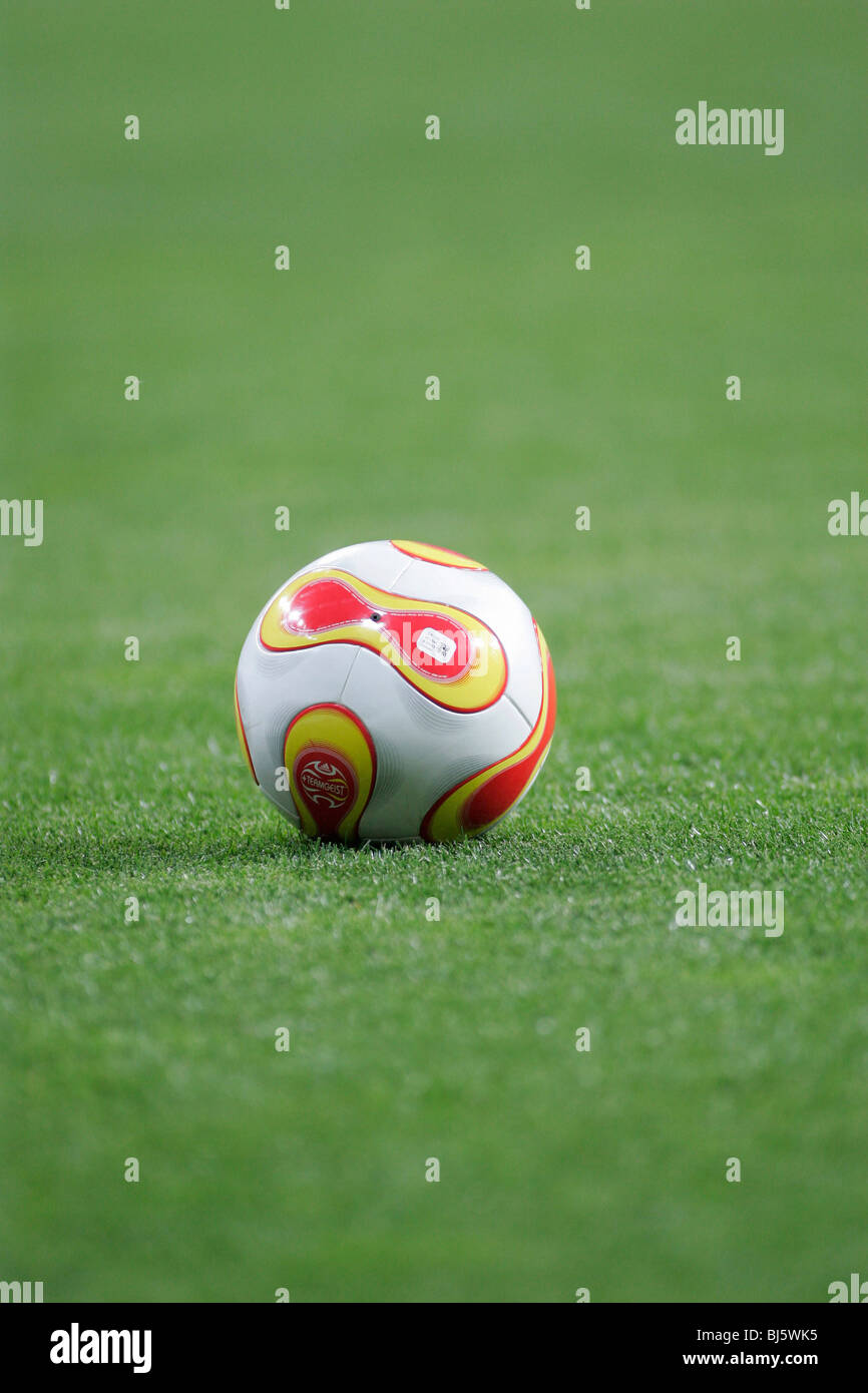 Football lying on the sports field - Stock Image