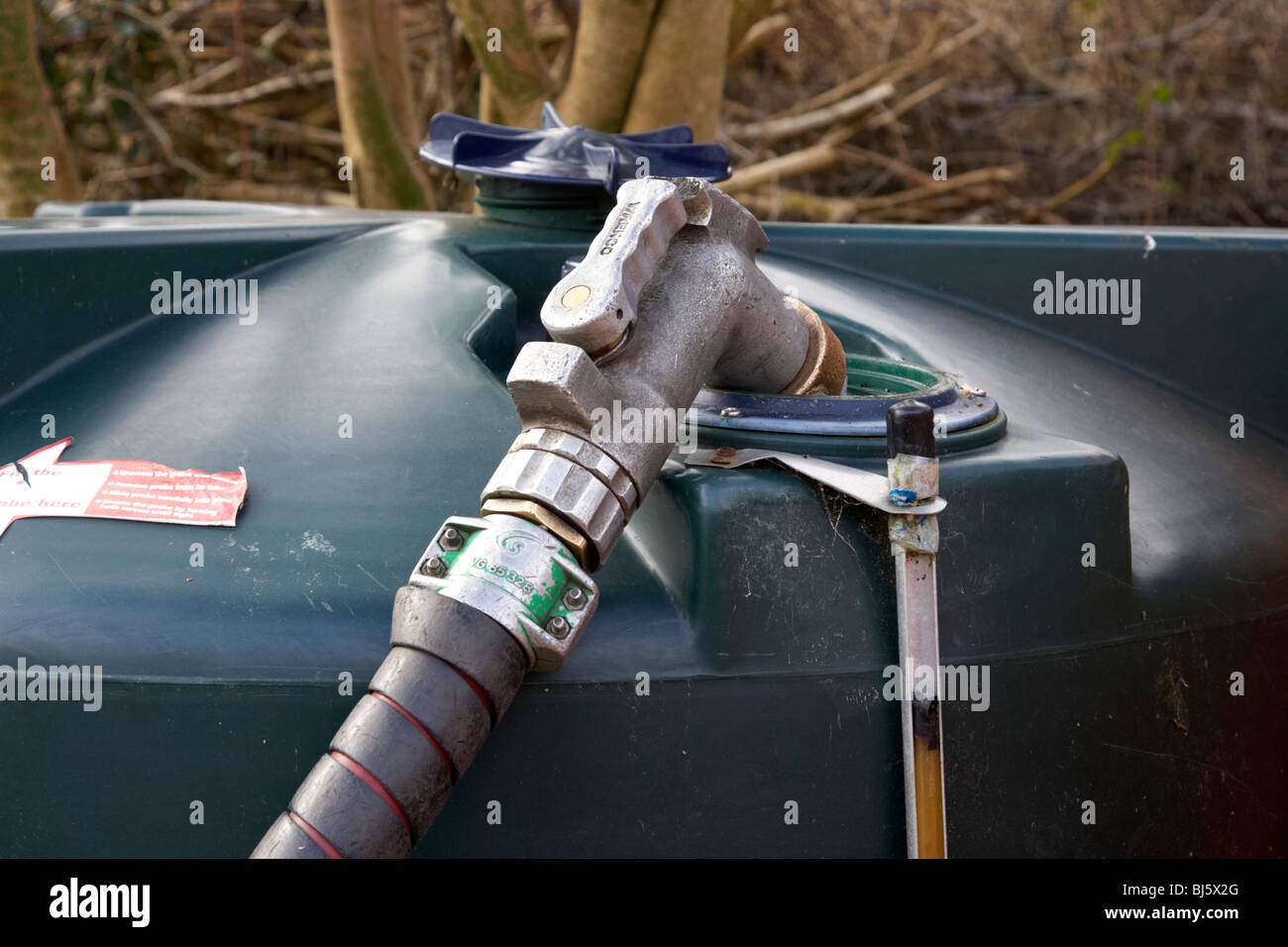 domestic home heating oil tank being refilled with 28 sec kerosene in a garden in northern ireland uk - Stock Image