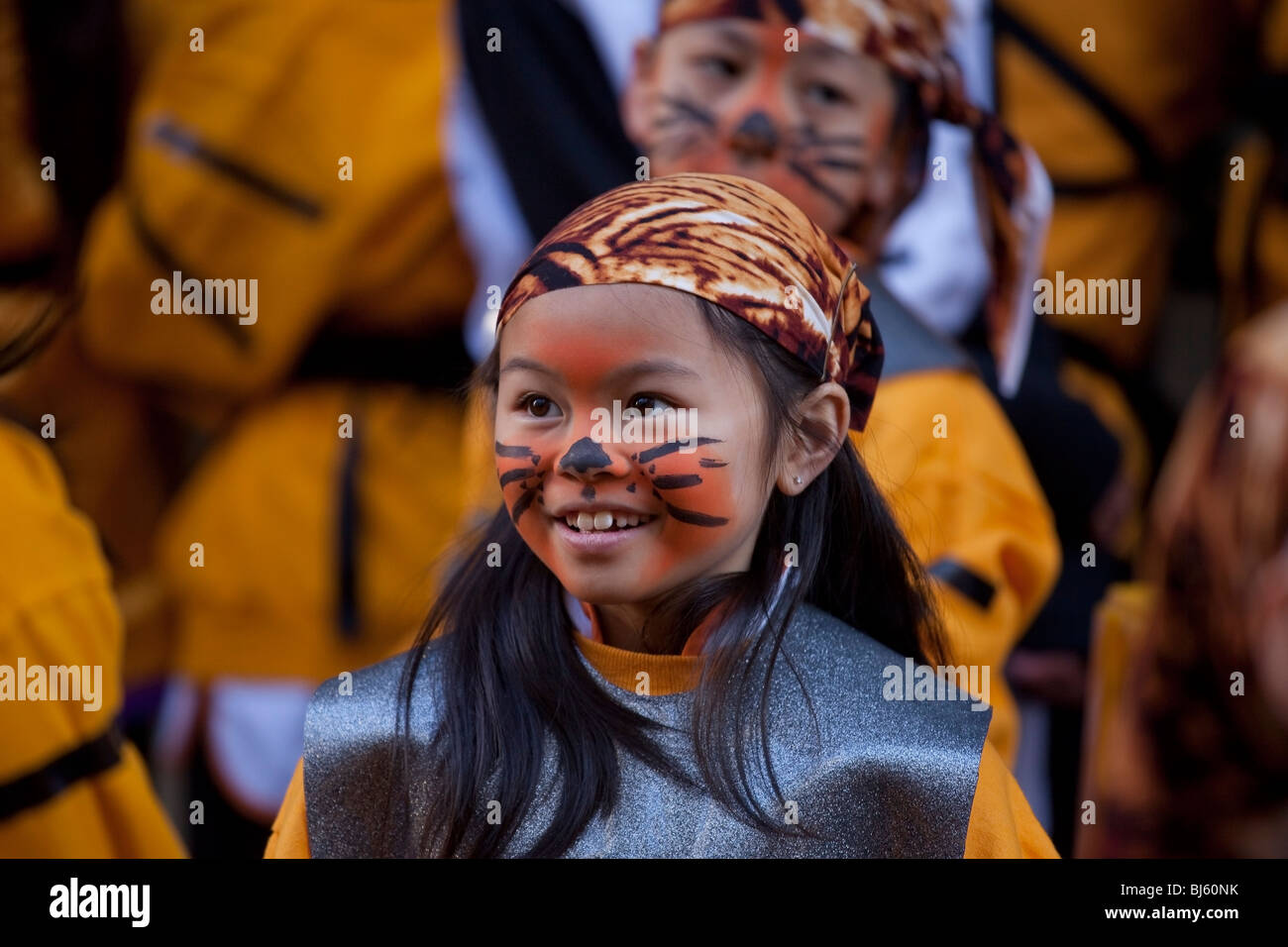Chinese girl in tiger costume and face painted for Chinese New Year Parade in San Francisco, California. - Stock Image
