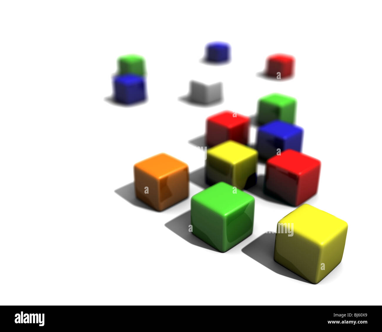 A bunch of colored blocks on a white ground. First block in focus and the rest blurring out due to depth of field - Stock Image