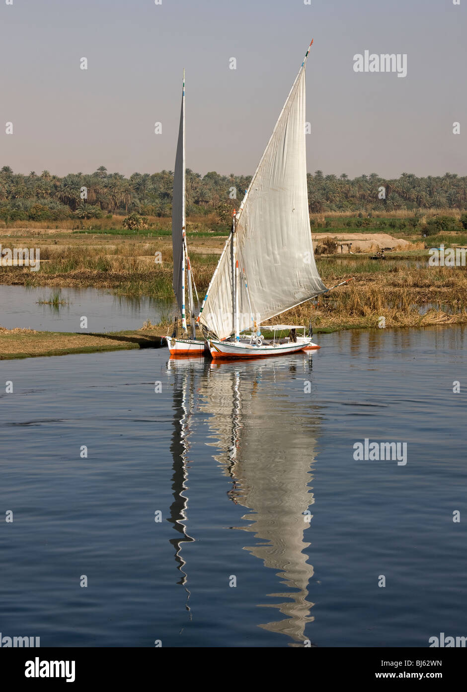Two Feluccas stationary along the bank of the river Nile. - Stock Image
