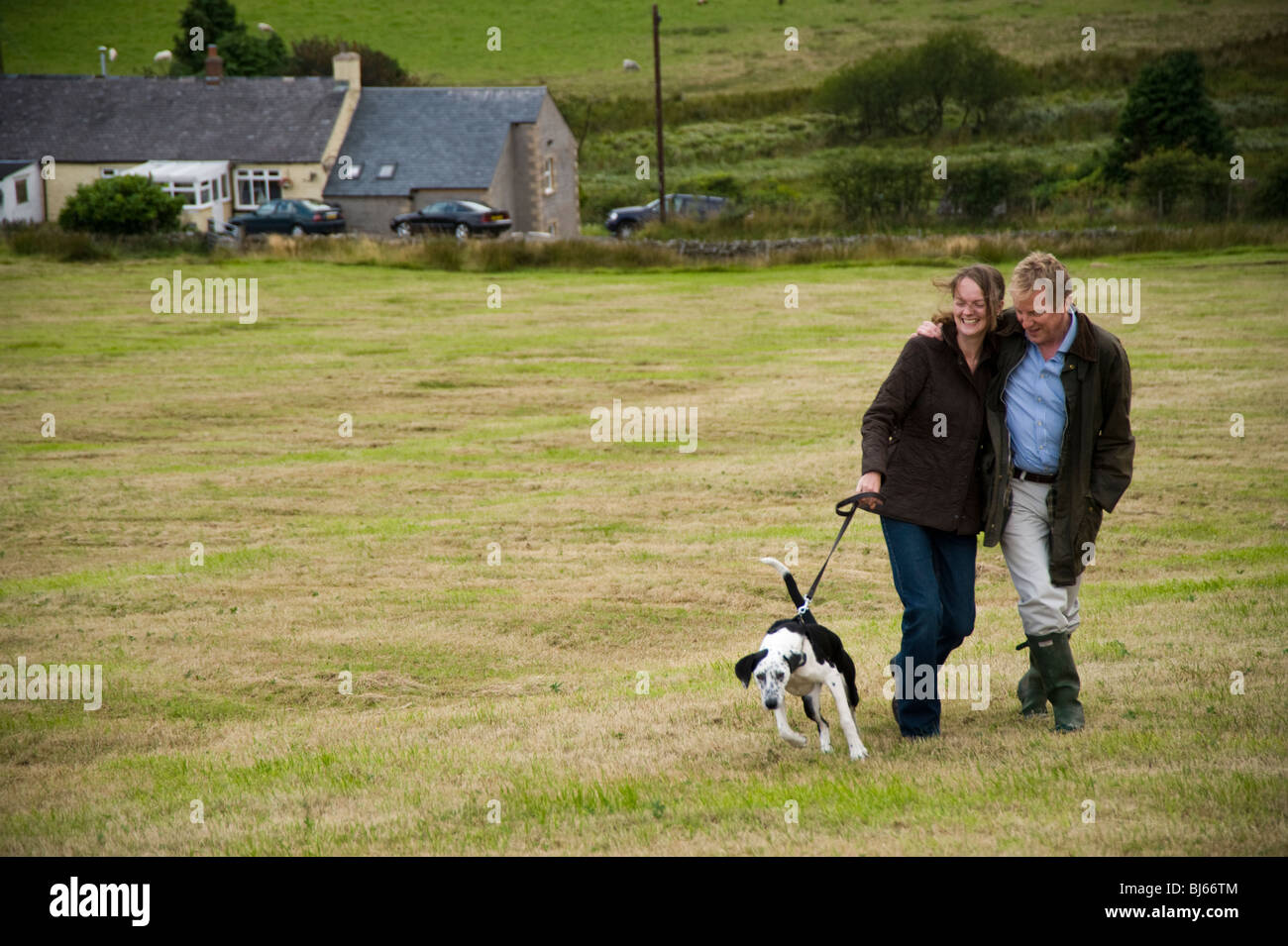 Happy married couple walking and enjoying their country lifestyle, Cumbria, uk - Stock Image