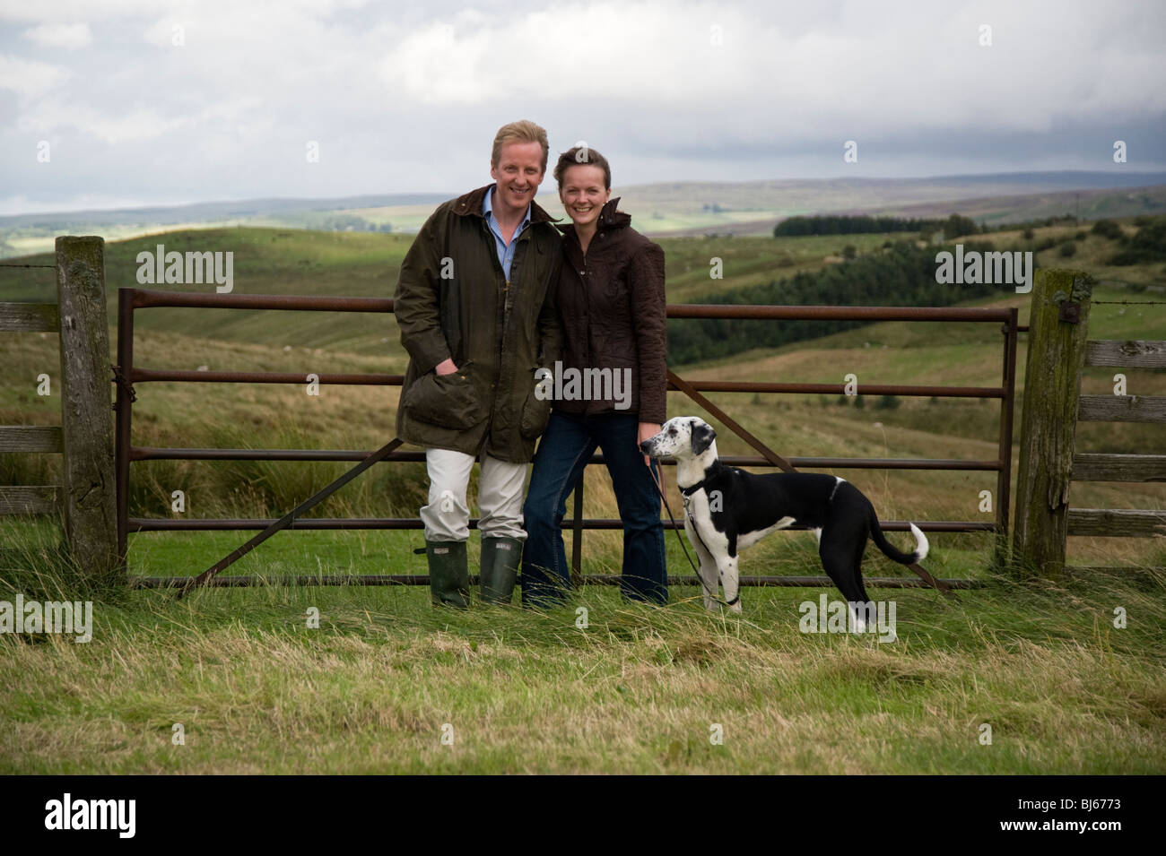 Married couple with pet dog enjoying their country lifestyle, Cumbria, uk - Stock Image