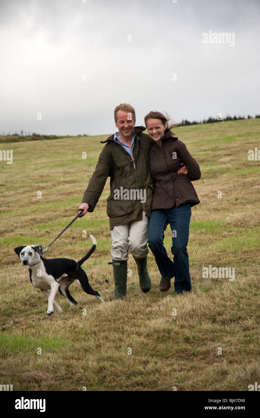 Married couple walking and enjoying their country lifestyle, Cumbria, uk - Stock Image
