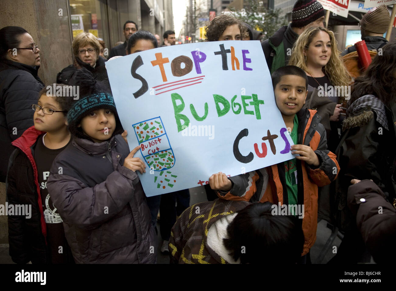Children with parents and teachers protest budget cuts to education in New York City. - Stock Image
