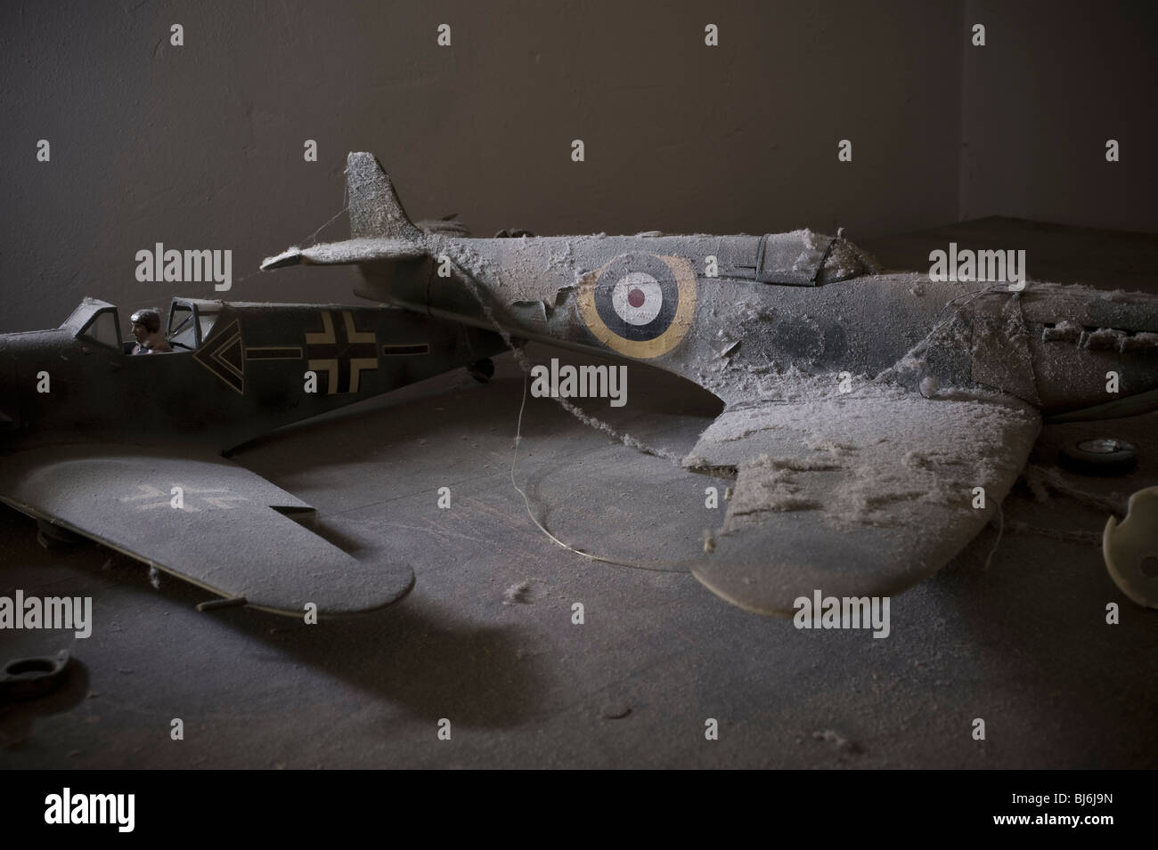 Scale models of a Spitfire and Messerschmidt 109 covered in dust and forgotten - Stock Image