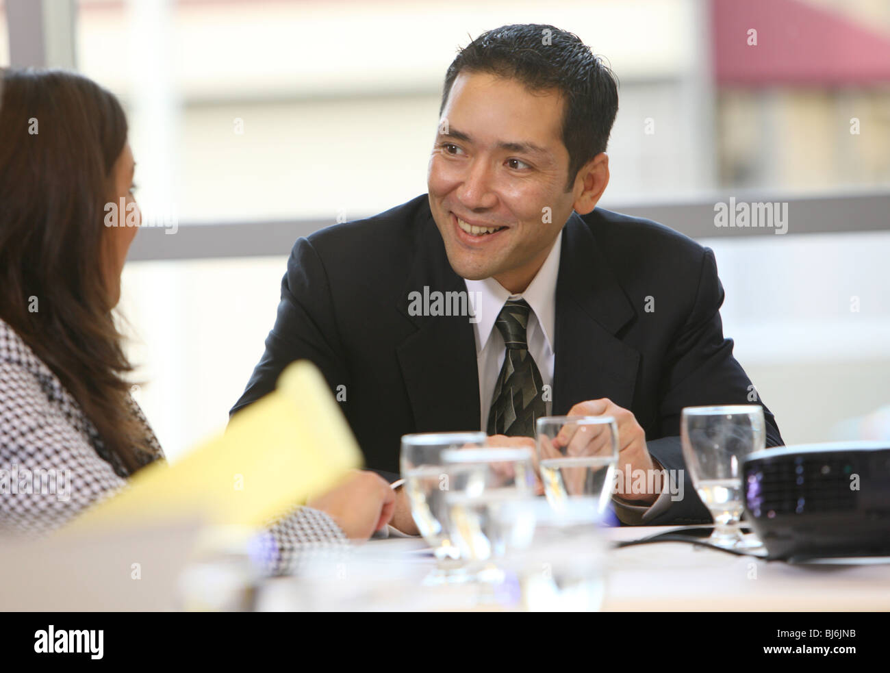 Business people in board room meeting - Stock Image