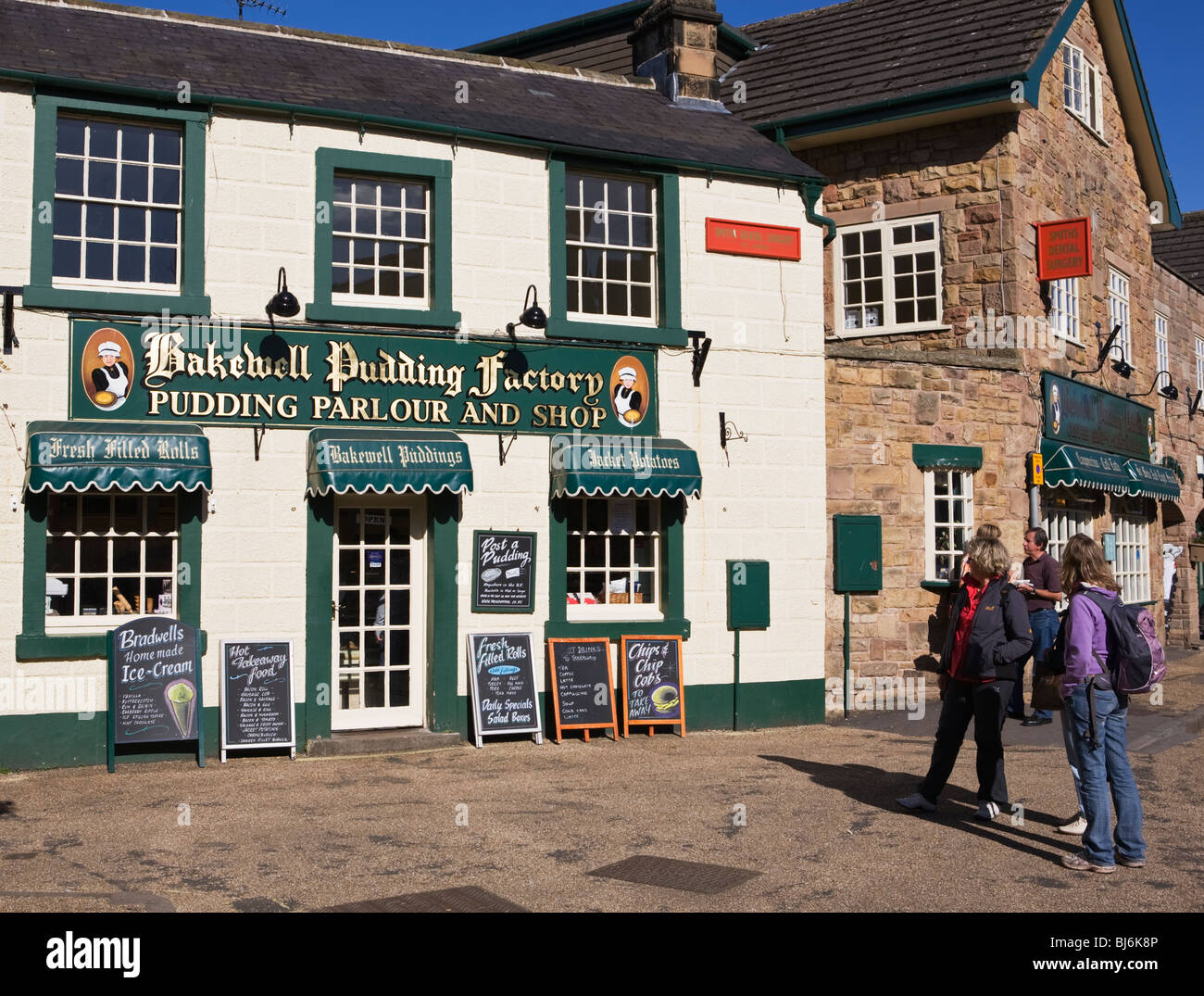 Tourists outside the Bakewell Pudding Factory shop Derbyshire England UK - Stock Image
