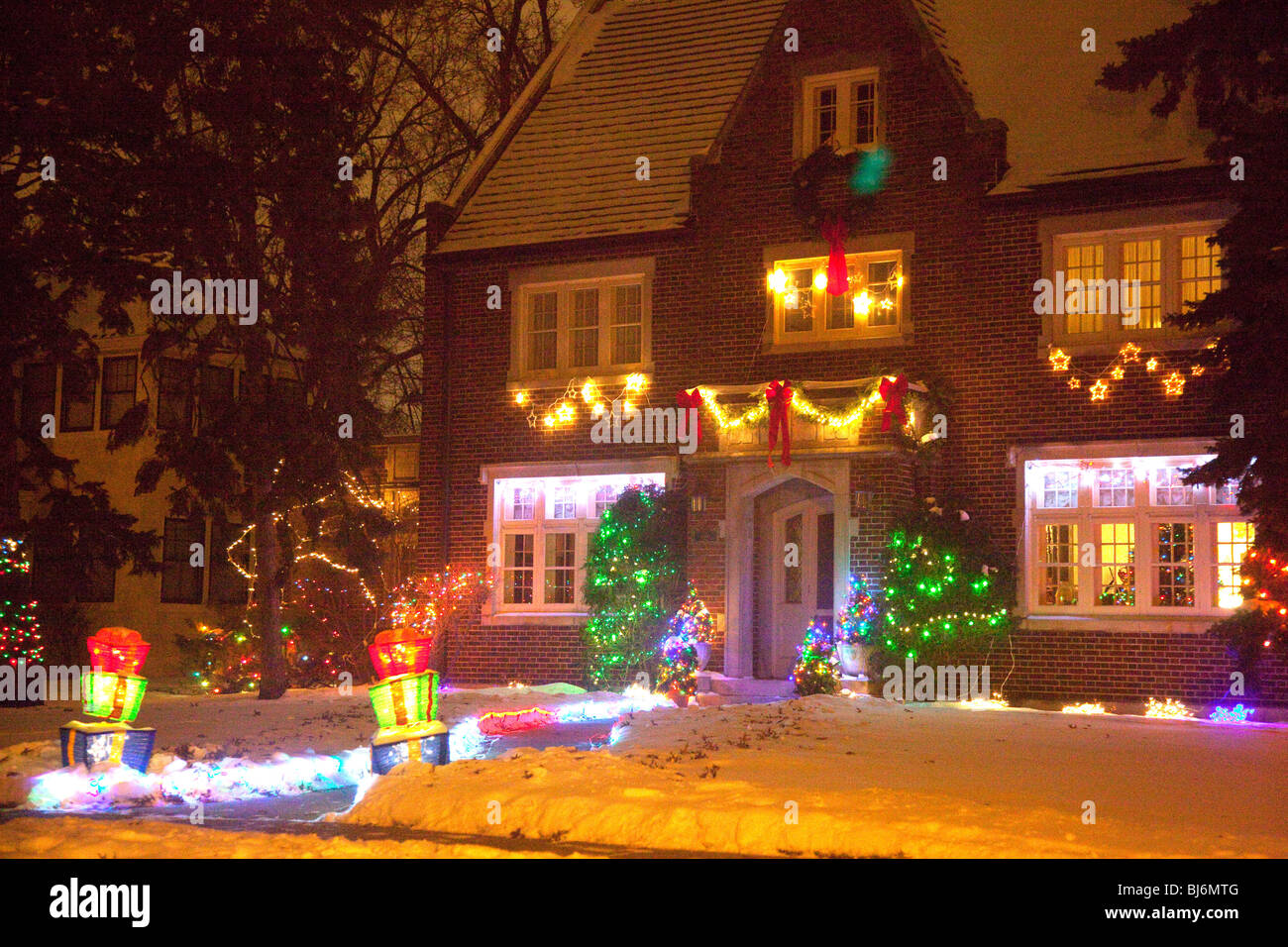House Decorated With Outdoor Christmas Lights At Night St Paul