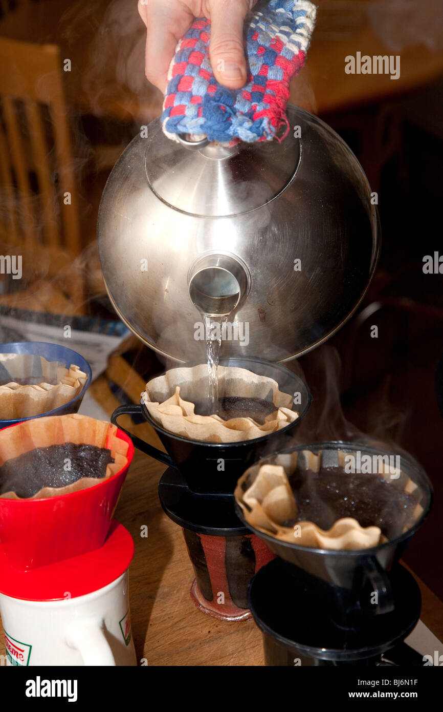 Making brewing filtered coffee by pouring hot water over coffee grounds. St Paul Minnesota USA - Stock Image