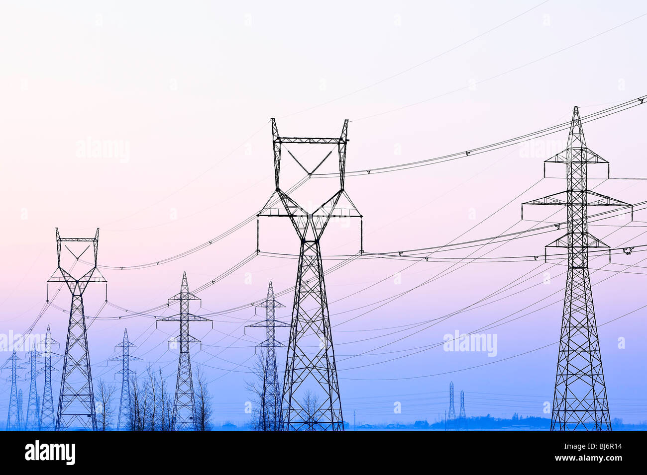 Power transmission lines and towers at dusk, near Winnipeg, Manitoba, Canada. - Stock Image