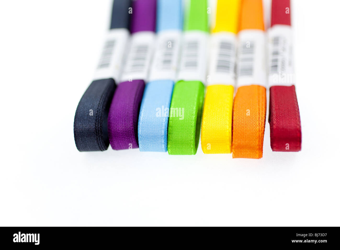 seven colored ribbons on white background. closeup - Stock Image