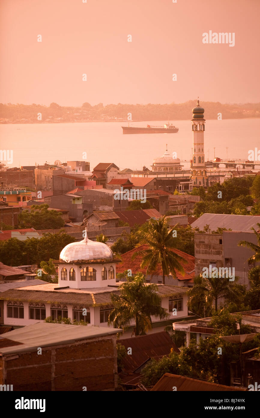 Indonesia, Sulawesi, West Coast, Pare Pare, town centre in late afternoon light - Stock Image