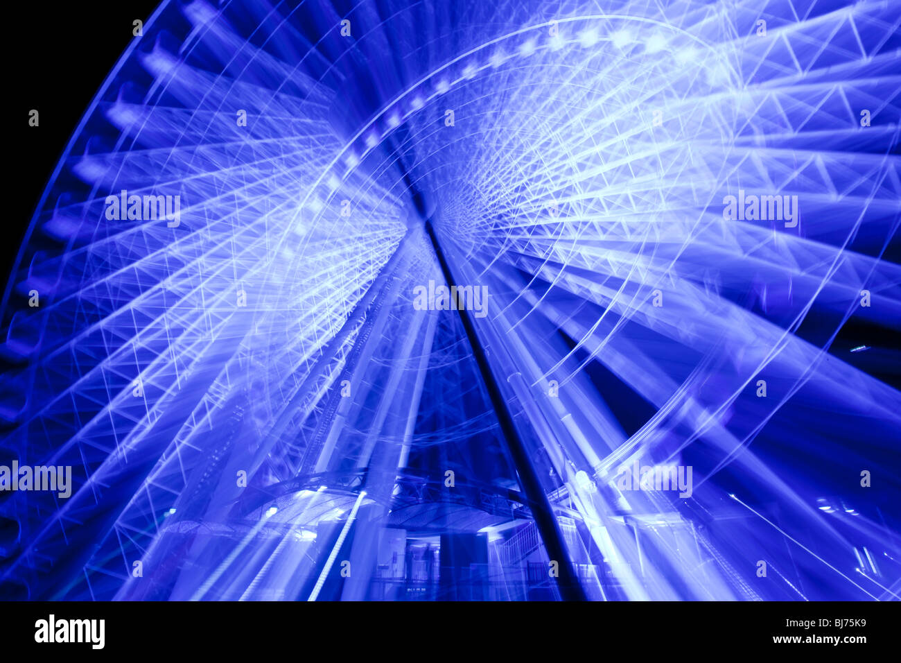 Sky wheel illuminated at night Stock Photo