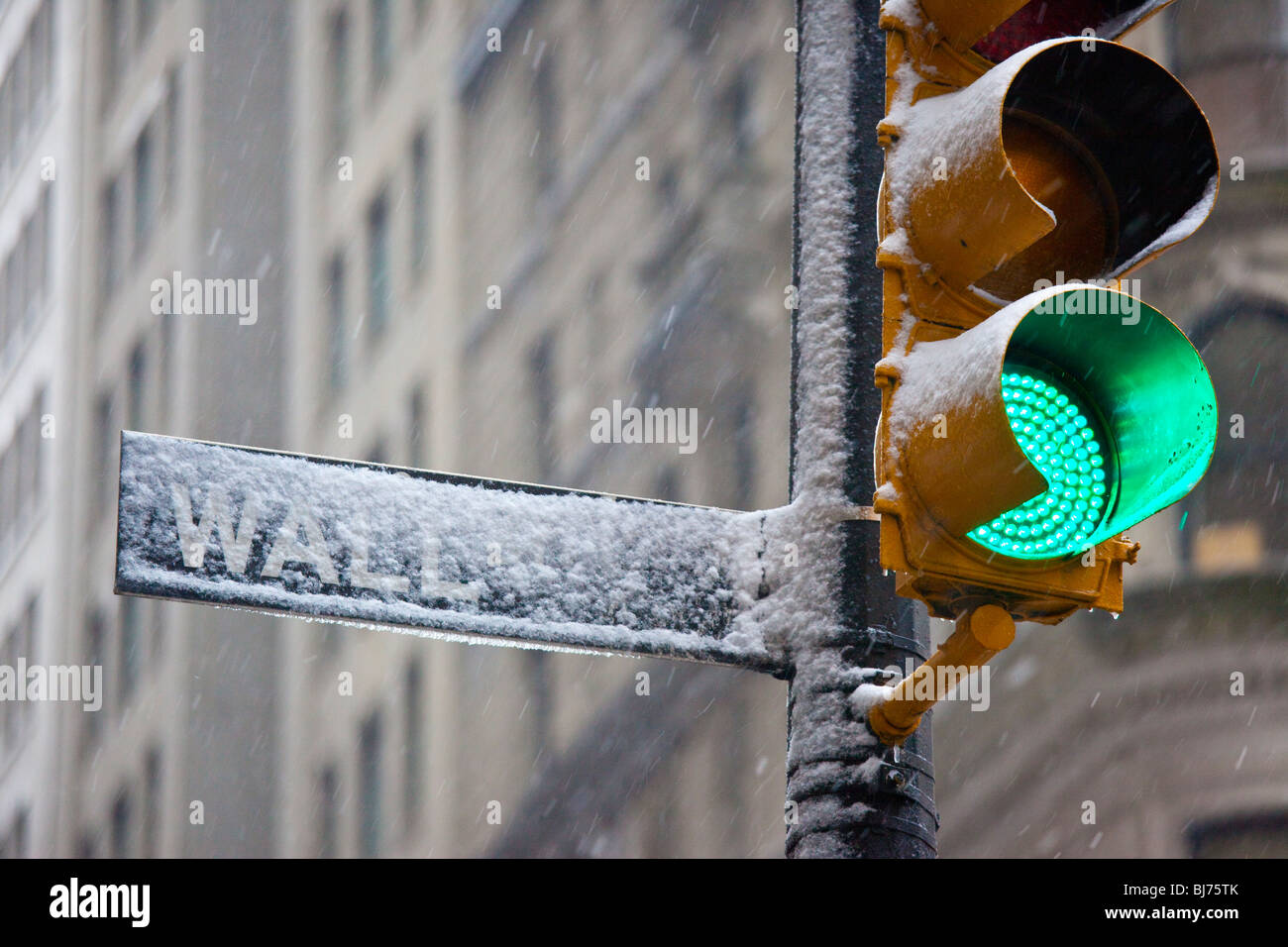 Wall Street Sign in a snow storm in New York City - Stock Image