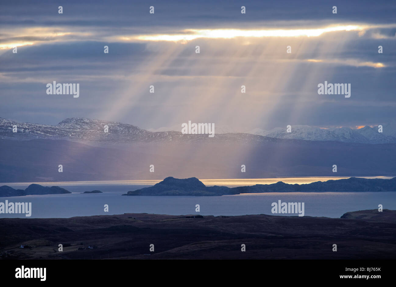 Sunbeam over the Isle of Raasay and The Minch. Seen from Trotternish, Isle of Skye, Scotland, UK. Stock Photo