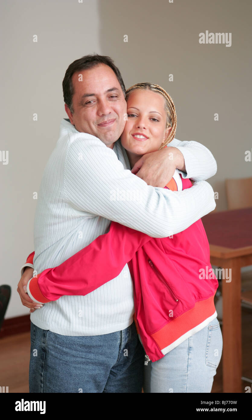 Middle aged man hug younger woman - - Stock Image