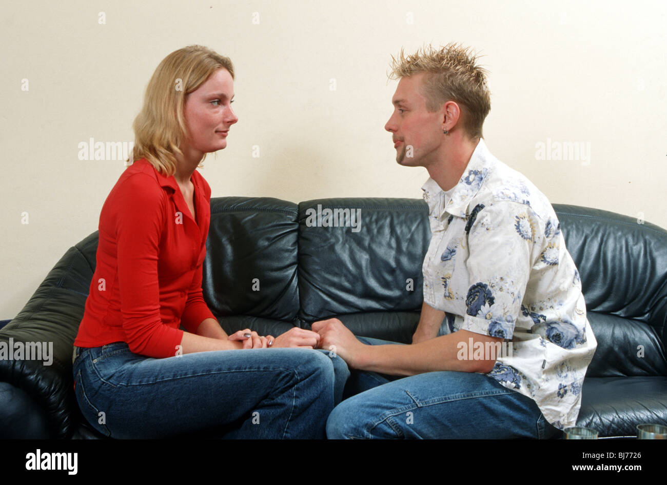 Couple having a talk on the couch at home - SerieCVS500202167 Stock Photo