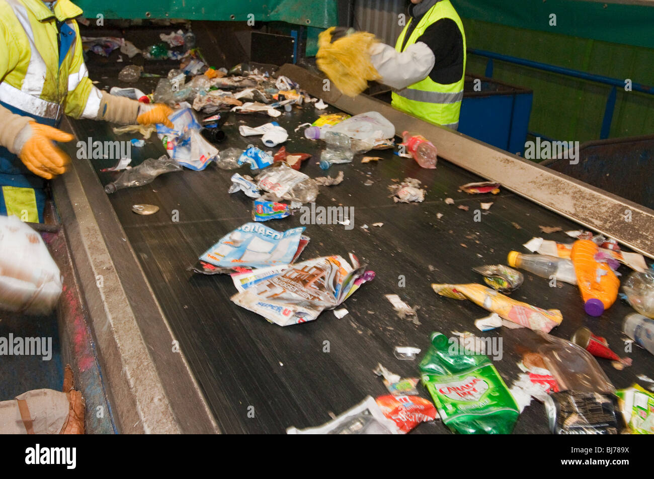 Rubbish on a conveyor belt for sorting at a recycling center - Stock Image