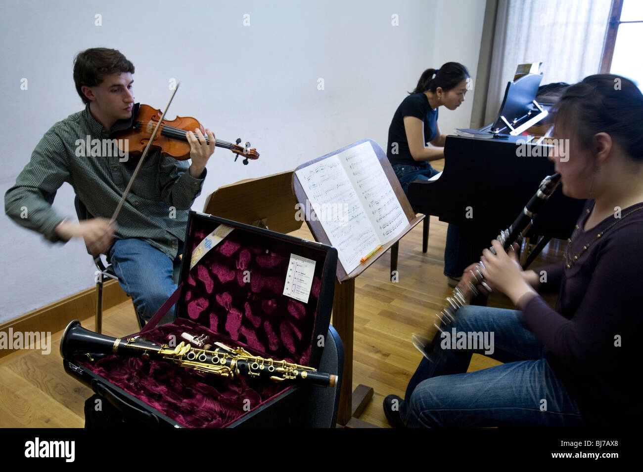 Music students rehearsing a Violin, Clarinet and Piano Trio Stock Photo