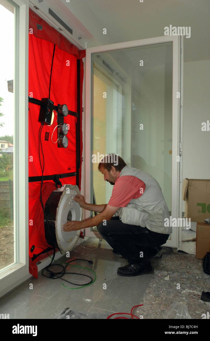 Blower door test in a passive house, Berlin, Germany - Stock Image