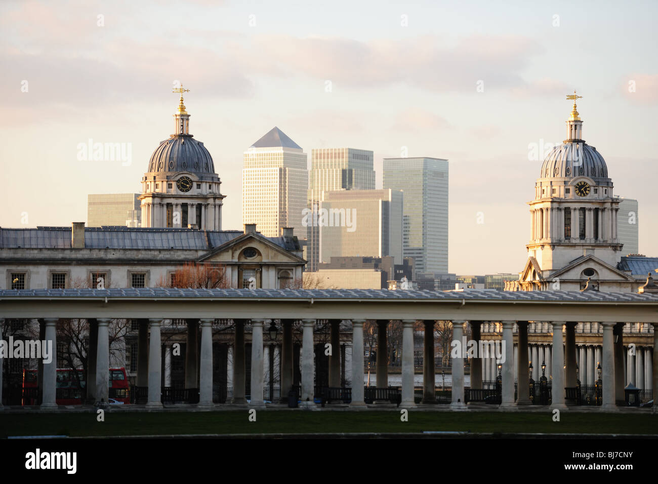 Towers of the Old Royal Naval College, Greenwich, London, UK, a world heritage site, with Canary Wharf in the background Stock Photo