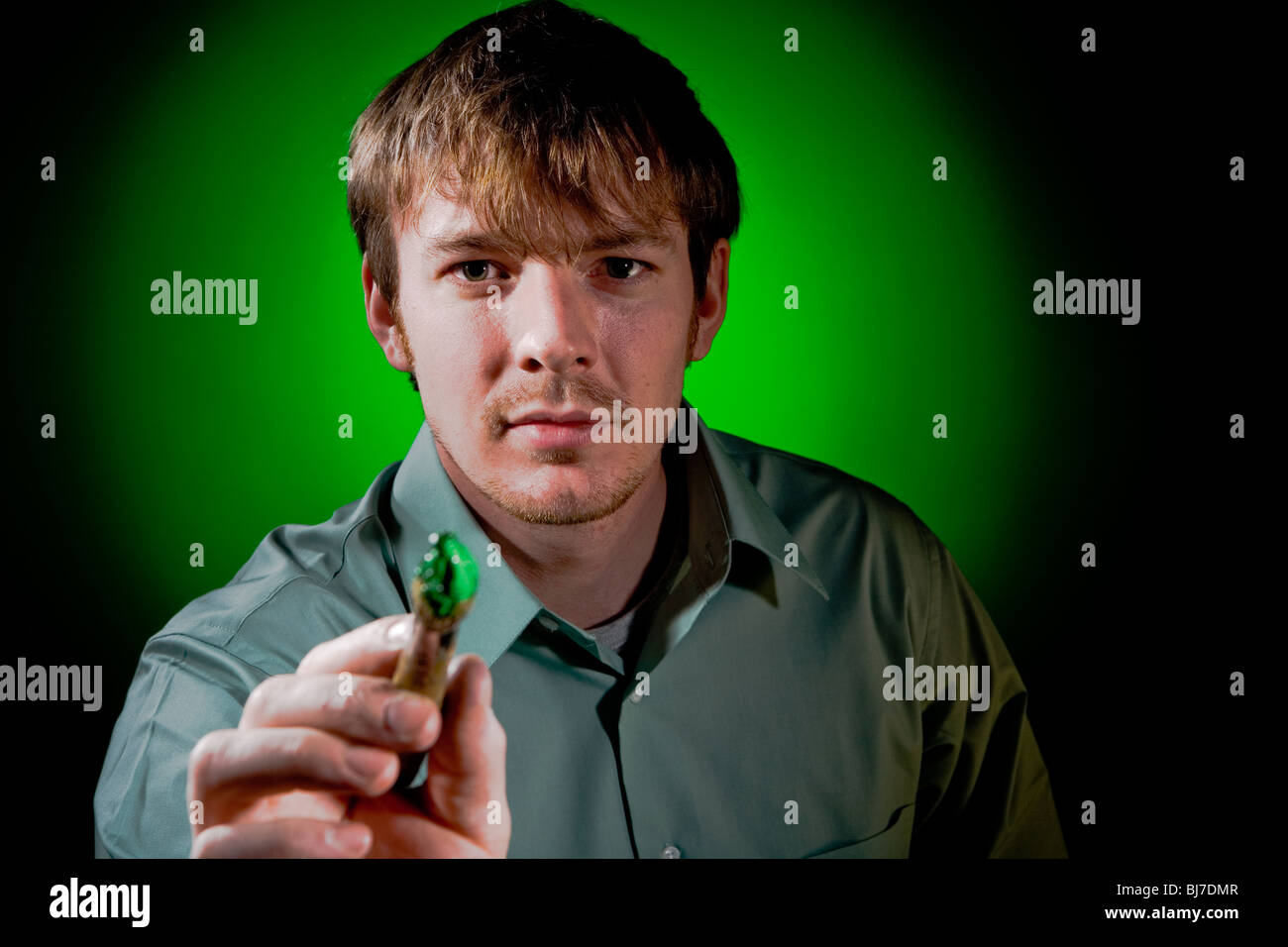 Painter on Green - Stock Image