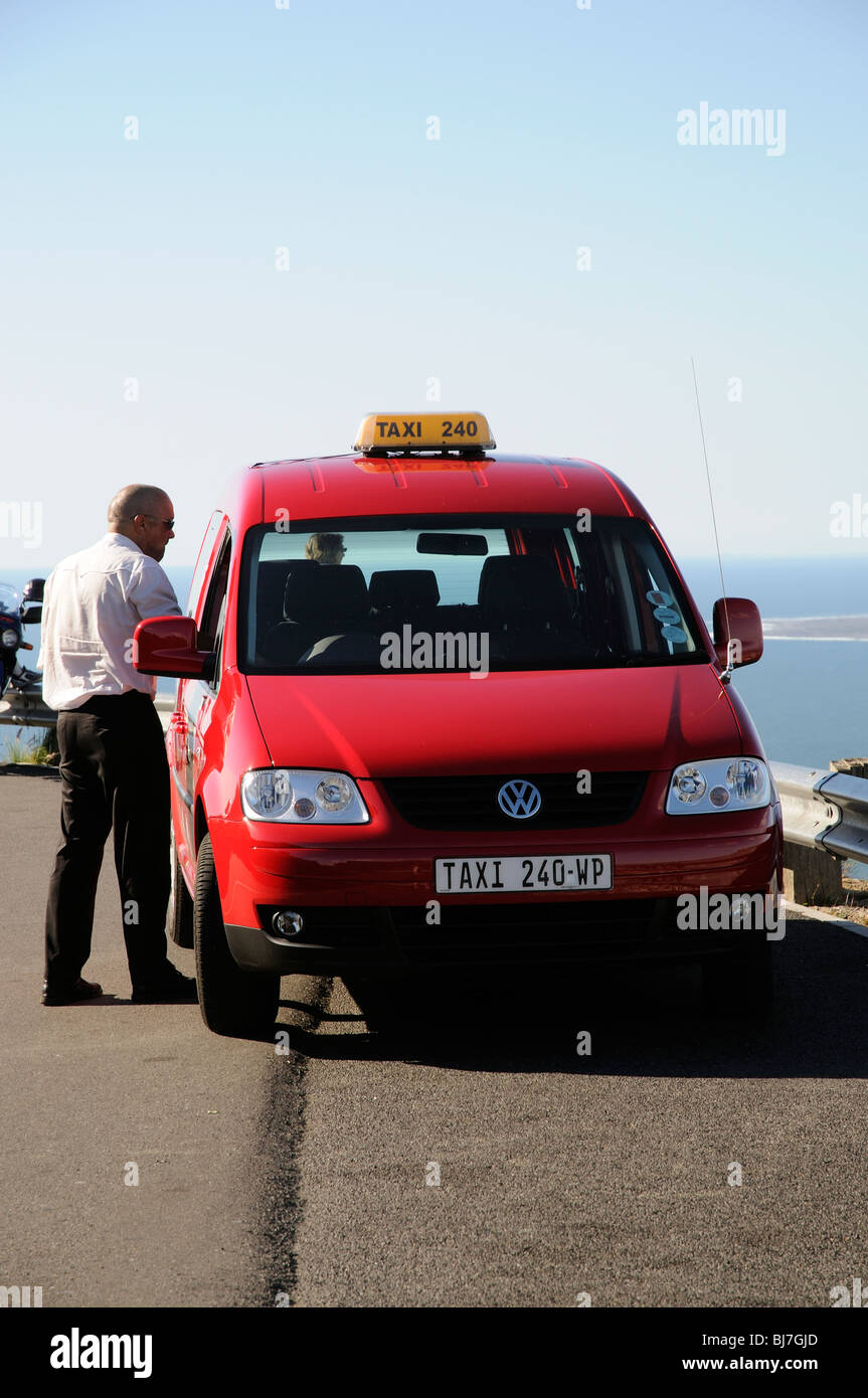 A red taxi showing a taxi number plate Cape Town South Africa - Stock Image