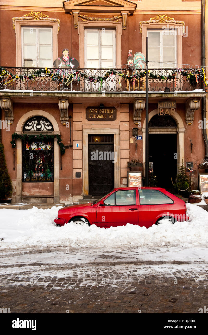 Snowed in car in the Old Market Square in Warsaw Poland - Stock Image