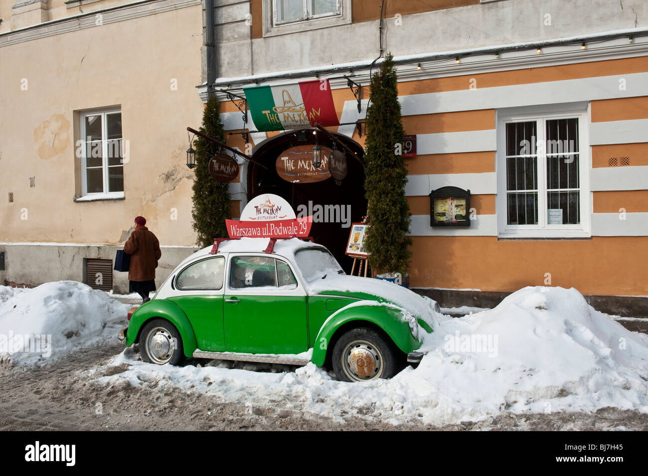 A VW car parked in a snowdrift in Warsaw Old Town Poland - Stock Image