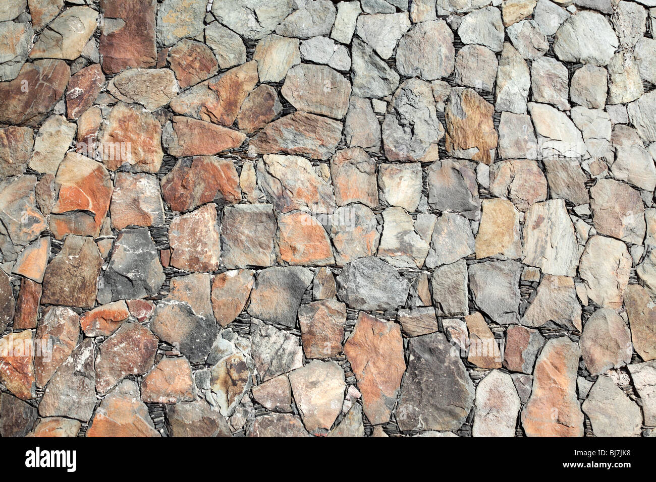 rock wall detail as a background - Stock Image
