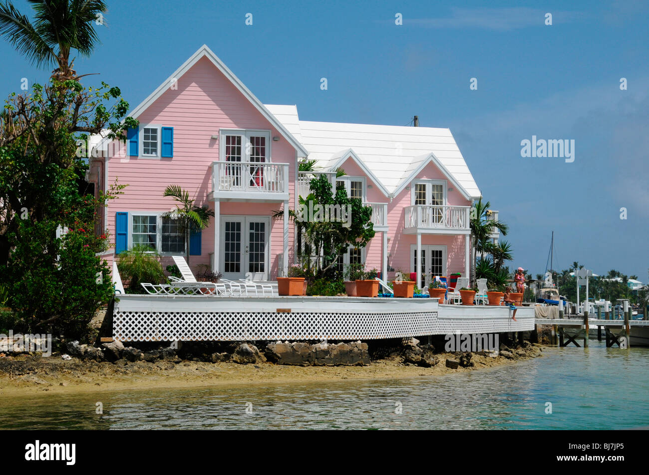 Boy Fishing From Pink Rental Houses At The Entrance To Hope Town Harbour,  Elbow Cay, Abacos, Bahamas