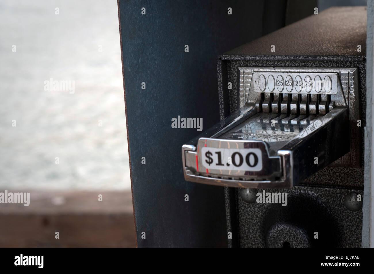 A quarter coin operating dispenser. - Stock Image