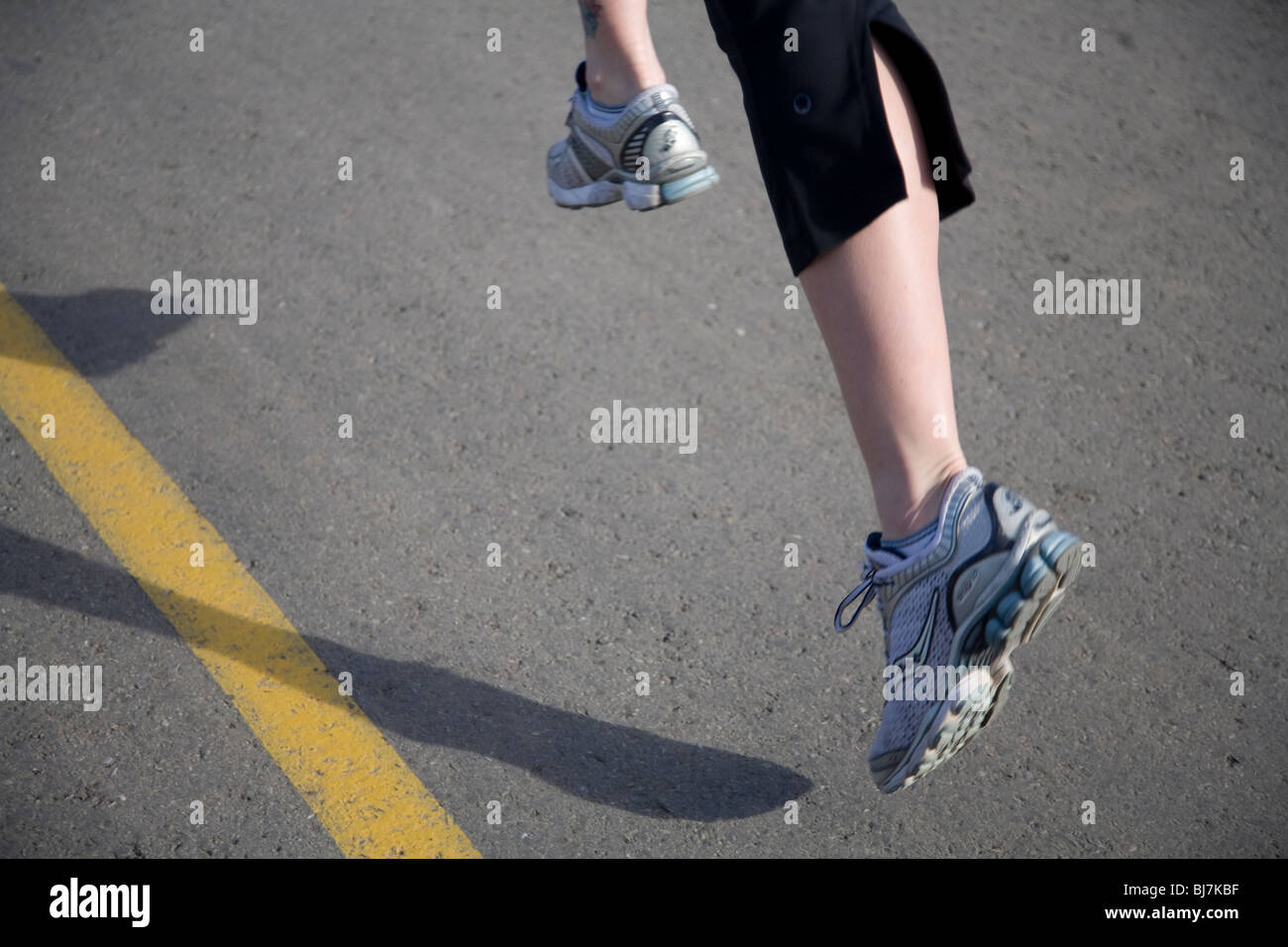 Close-up of a runner's feet and legs Stock Photo