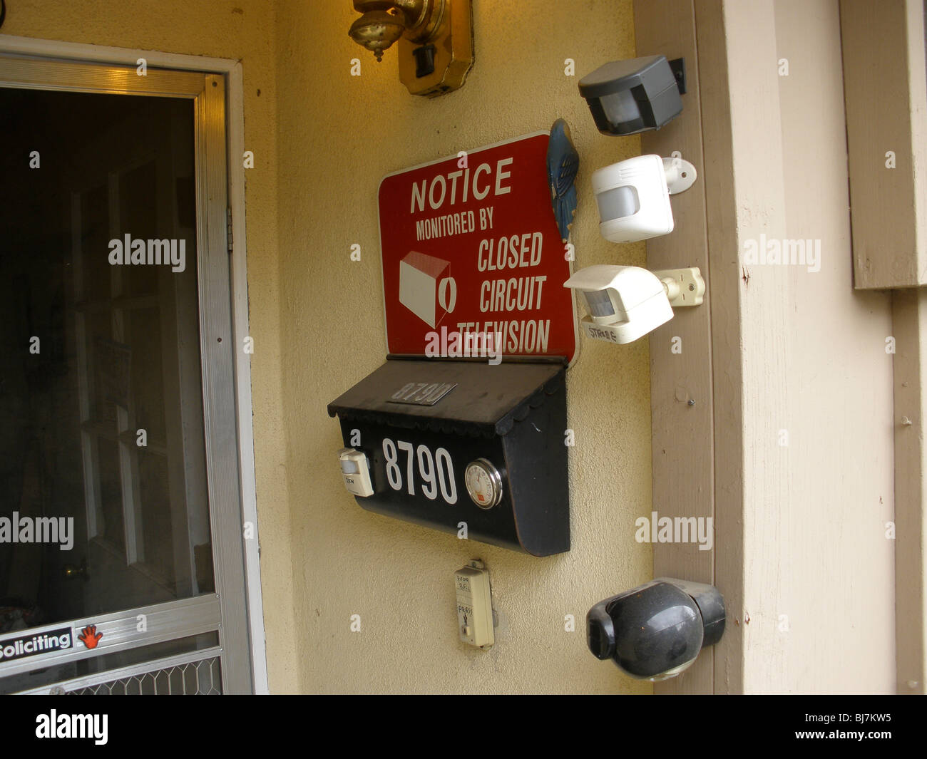 A surveillance camera at the front entrance of a home. - Stock Image