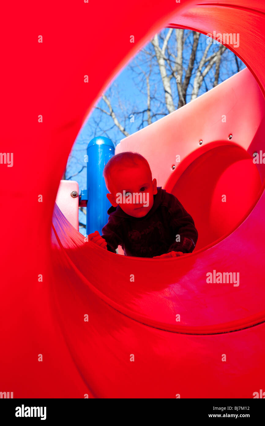 Young boy on a slide at a park in South Orange, New Jersey - Stock Image