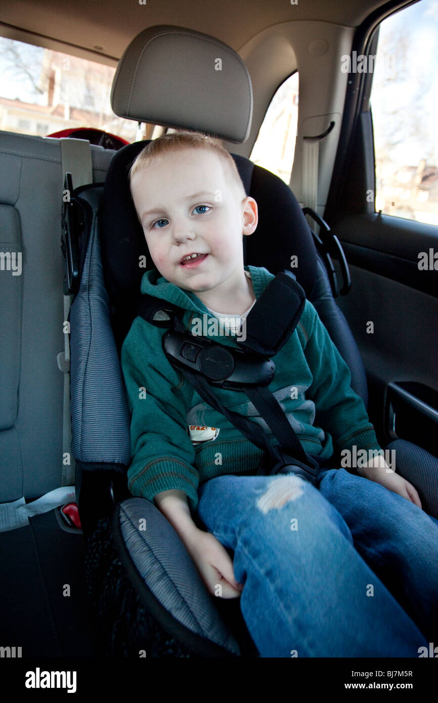 2 year old boy in a child seat in New Jersey, USA - Stock Image