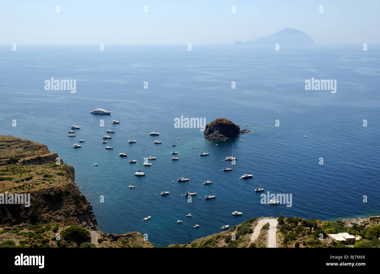 A view of the sea below Pollara with the Island of Filicudi on the horizon, Salina, Aeolian Islands, Italy. Stock Photo