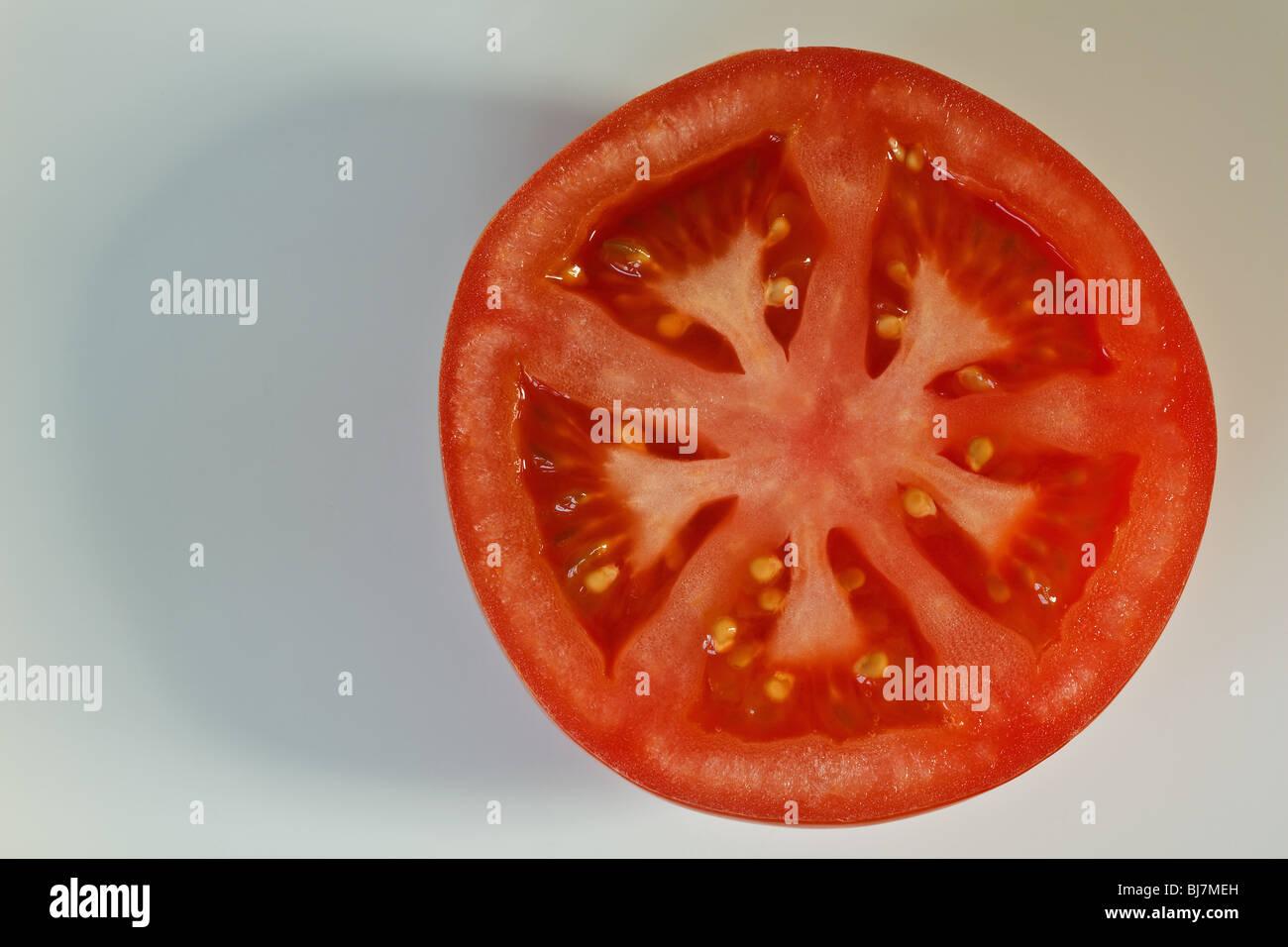 Close-up image of a half tomato - Stock Image