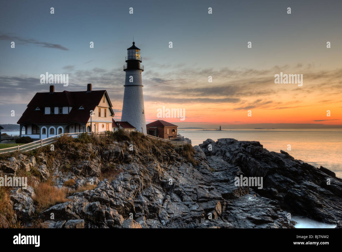 Portland Head Light, which protects mariners entering Casco Bay, at dawn.  The lighthouse is in Cape Elizabeth, - Stock Image