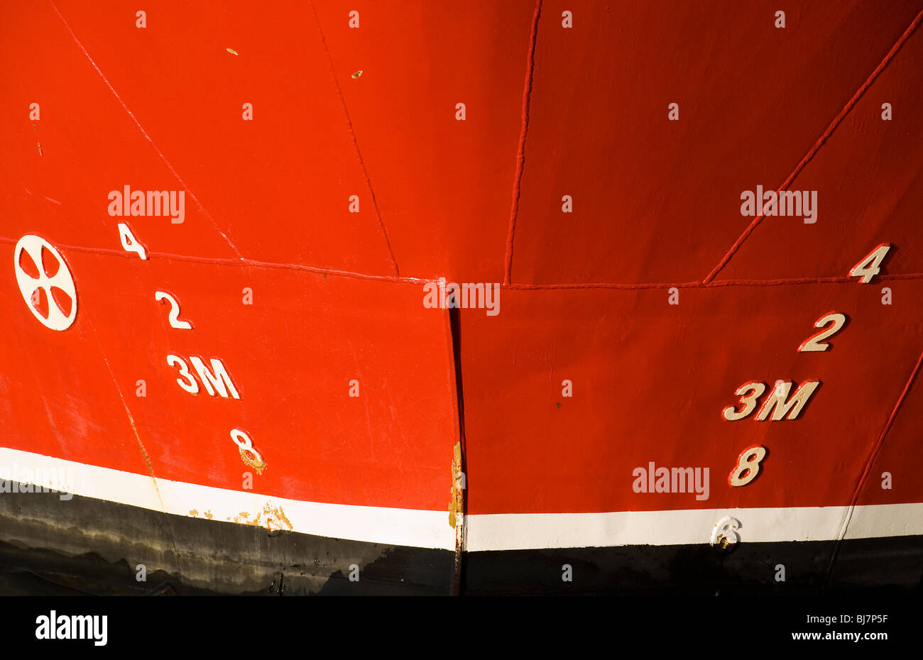 Plomsoll marks on ships bow showing the draft - Stock Image