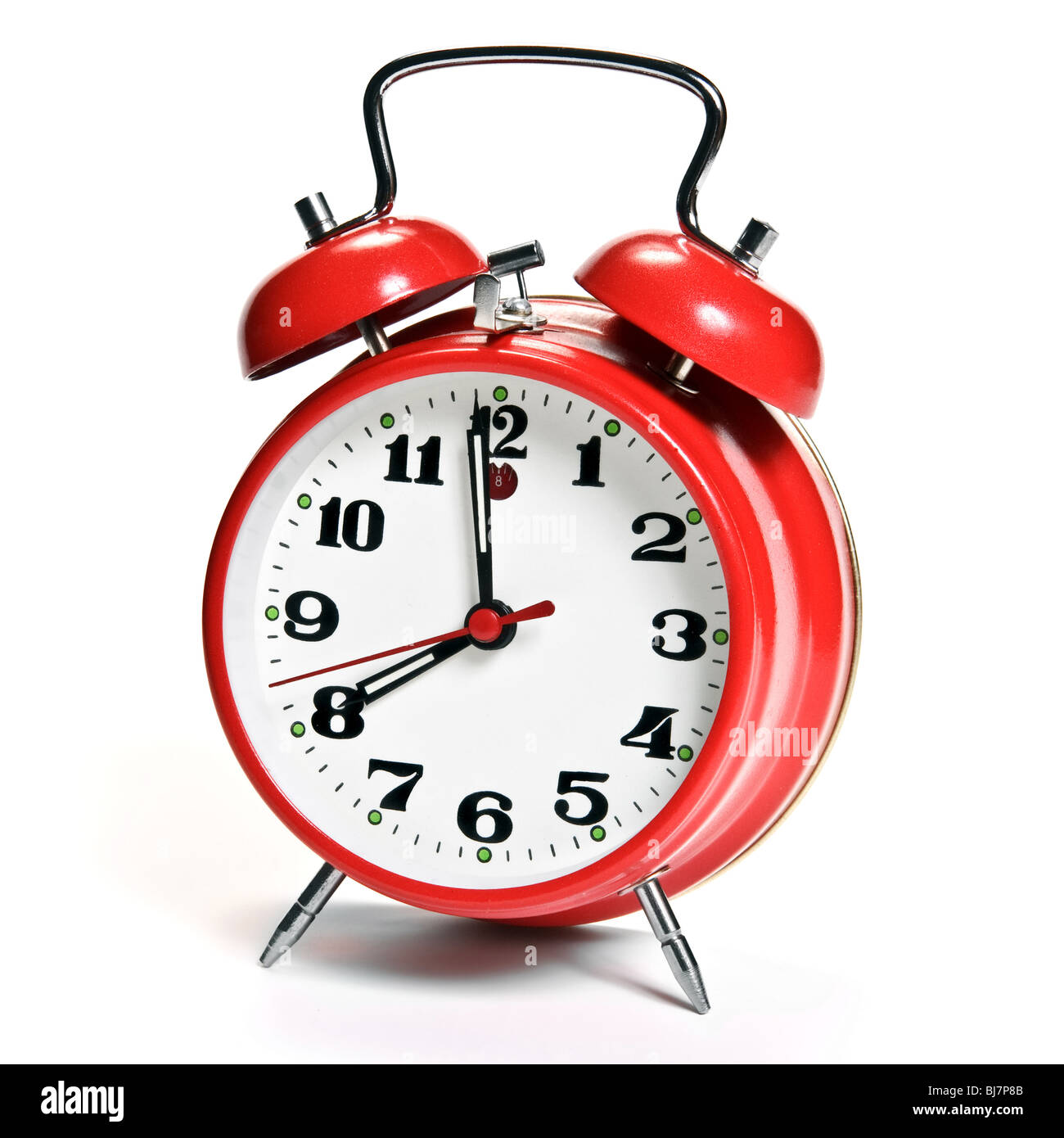 Red alarm clock isolated on white - Stock Image